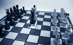 Chess kings on the crystal pedestale Royalty Free Stock Photo