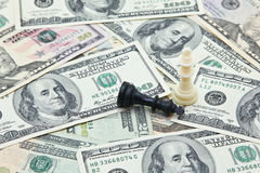 Chess kings on pile of US dollar banknotes Royalty Free Stock Photos