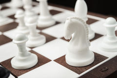 Chess knight on the chessboard Royalty Free Stock Photos