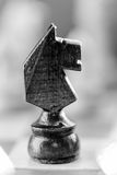 Chess knight pawn on chess board close up. Black and white. Macro vertical Royalty Free Stock Photos