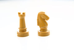 Chess knight and tower isolated on white Stock Image