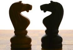 Chess knights silhouettes Stock Photography