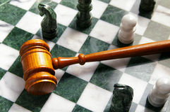 Chess law. Judges law gavel on a chess board, from above Stock Photography