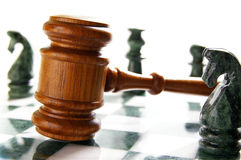 Chess law. Law gavel on a chess board with pieces Royalty Free Stock Images