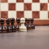 Chess leadership concept over chessboard. Chess leadership concept on the chessboard background Royalty Free Stock Photo
