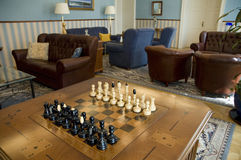 Chess in the luxury room Royalty Free Stock Photo