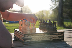 Chess man hand outdoor Royalty Free Stock Images