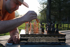 Chess man hand outdoor Royalty Free Stock Image