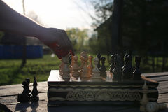 Chess man hand outdoor Royalty Free Stock Photo
