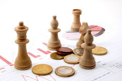 Chess man over business chart. Admonish to strategic behavior Royalty Free Stock Images
