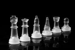 Chess metaphor. Chess pieces shown in order of rank. Can symbolize different levels of the corporate world Royalty Free Stock Images