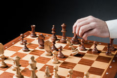 Chess move. Chess pieces on wood chessboard Royalty Free Stock Photo