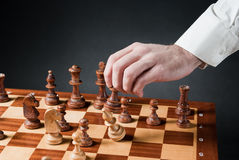 Chess move. Chess pieces on wood chessboard Stock Photo