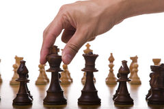The chess move. The king piece of a chess table ready for it's move (selective focus Stock Images