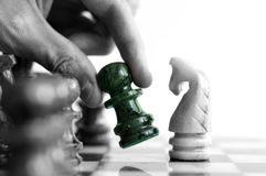 Chess move. Moving a chess piece (in color) across the board Stock Image