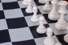 Chess opening with close-up on pawns. Chessboard opening position close up on pawns. The chess board can be used for business metaphors related to competition royalty free stock photography