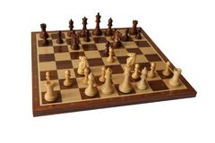 Chess opening. Four Knights Opening. Photo of the Four Knights Opening chess opening. White pieces in front and black in the back end of the board. Chess Stock Image