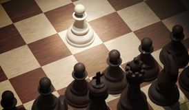 Chess opening move - pawn in center of board. View from top. 3D rendered illustration.  Royalty Free Stock Image