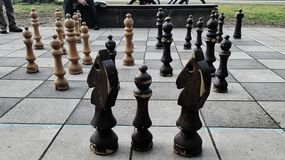 Chess outdoors. Giant chess game outdors Royalty Free Stock Images