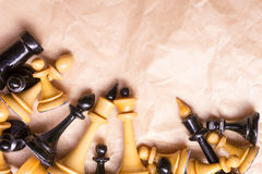Chess on paper background. Face to face, first step. Copy space for text. Stock Photography