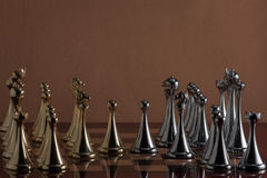 Chess party. The photo shows the chessboard with metal figures Royalty Free Stock Images