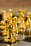 Chess (Pawn). Chess pieces (pawn) on the game board Stock Images