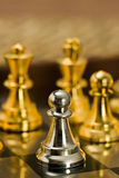 Chess (Pawn). Chess pieces (pawn) on the game board Royalty Free Stock Images