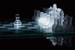 Chess pawn against all spotlight Stock Images