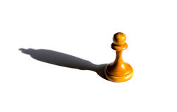 Chess pawn casting a king piece shadow concept of strength and Royalty Free Stock Photos