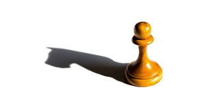 A chess pawn casting a knight piece shadow concept of strength Stock Photos
