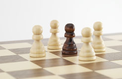 Chess pawn on chessboard Stock Photography