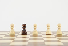 Chess pawn on chessboard Stock Images