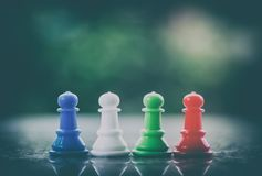 Chess pawn on dark tone background. For teamwork and business strategy concept stock images