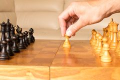 A chess pawn in a human hand. The beginning of the chess game. T stock images