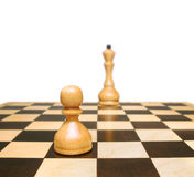 Chess. Pawn and queen. Stock Photos