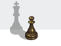 Chess pawn with the shadow of a king Royalty Free Stock Photography