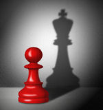 Chess pawn with the shadow of a king. Red chess pawn with the shadow of a king Royalty Free Stock Images