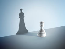 Chess pawn with the shadow of a queen Royalty Free Stock Images