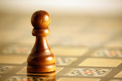 Chess - Pawn. A single pawn on an ornate chess board stock photos