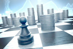 Chess pawn versus cash on a blue financial background Stock Photo