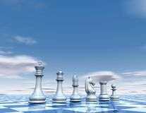 Chess pawns abstract pawns set. Surreal blue background with clouds and chess board Royalty Free Stock Photos