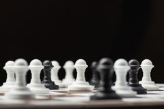 Chess pawns on a board Royalty Free Stock Images