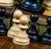 Chess pawns both black and white Royalty Free Stock Photo