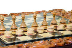 Chess pawns and checkers Stock Photo