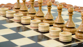 Chess pawns and checkers Stock Images