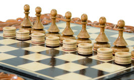 Chess pawns and checkers Royalty Free Stock Photos