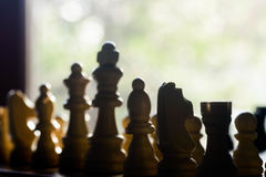 Chess pawns on chessboard. Closeup to chess pawns on chessboard Stock Image