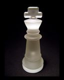 Chess Piece 1. A white Chess piece shot on a black background Royalty Free Stock Photo
