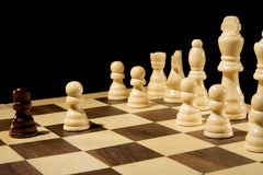 Chess piece on board isolated on black Royalty Free Stock Photography