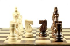 Chess Piece on Chessboard. Chess strategy chess board chessboard chess knight isolated on white focus on foreground Stock Image